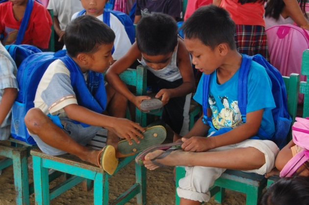 Children receive flip flops at a Quota sponsored school in Iloilo, Philippines.