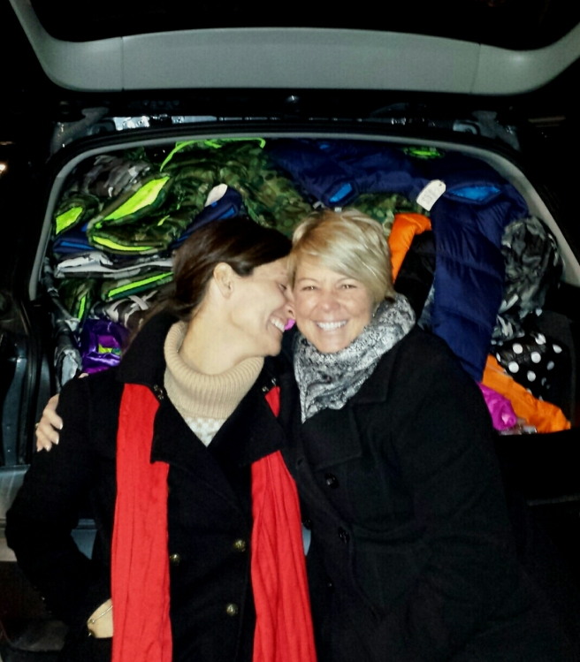 "Quota Volunteers Norie and Debbie are excited and ready to hand out the new coats for the ""Keep Children Warm"" Campaign in Winchester, VA, USA."