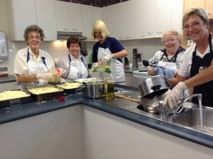 Quotarians in Brisbane make meals at the Ronald McDonald House.