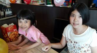 Sisters who received hearing aids