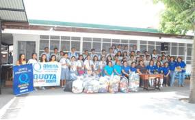 Photo of students at local high school with sewing supplies.